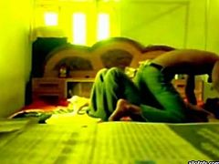 Slutty and filthy dark haired bitch with nice ass and sexy dark haired guy lays on the bed with his girl. Have a look in steamy The Indian Porn sex clip.