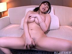 Curvy Japanese girl is getting naughty in the living room. She strips and demonstrates her amazing huge boobs for the camera and then moves her legs apart and fingers her meaty pussy.