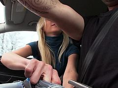 This sexy blonde is about to try something she has never tried before; she going to give head while she's in the passenger seat. The driver really enjoys this sloppy blowjob. First she works the cock with her hand gently and before long her lips are all over it.