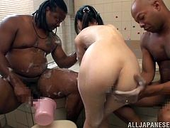 Watch this brunette doll, with small boobs in pigtails, while she gets her body washed in a bath and she also gets touched by horny men.