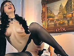 Dark haired and defiant lady Nina Young in hot black stockings shoves fingers and toys in wet pussy