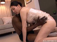 This naughty Japanese MILF loves Black guys. Sophia poses for the guy in panties and a negligee. This Black dude oils Sophia up and touches her juicy boobs.