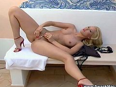 Blonde babe Sophie Moon strips and shows her nice body for the camera. Then she lies down on the sofa and masturbates her smooth coochie.