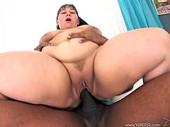 Have fun watching this chubby MILF, with big knockers wearing red panties, while she has interracial sex with a steamy fellow and moans stridently.