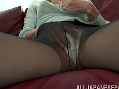 Have a blast watching this Japanese girl, with born breasts wearing nylon pantyhose, while she touches herself sitting on a couch.