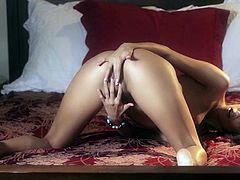 She is so horny, she can't wait anymore. She licks her fingers and moves them down, into her panties. What a naughty girl she is. She seductively masturbates, as she thinks, no one is watching her, but we are!