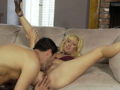Horny guy seduces mature lady for sex. They sip champagne before the woman starts stripping. When she is completely naked she lies on a couch with her legs wide open letting the guy eat out her pussy.