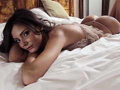 Press play to watch this brunette doll, with a nice ass wearing a thong, while she movers erotically on her big bed. She's a dangerous girl!