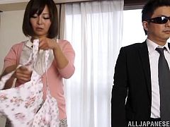 Sizzling Japanese milf Sayuki Kanno strips and shows her amazing body to some man. Then she kneels in front of the dude and drives him crazy with a great blowjob.
