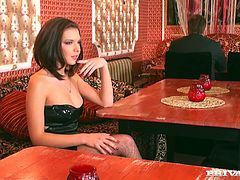 A hot girl in a black dress and fishnet stockings talks to a barmen in an empty strip club. This conversation turns to a wild anal sex. The girl gives head to the barmen. Then she takes hard butt fucking.