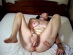 A lustful brunette chick fondles her juicy boobs and hairy pussy. Then this solo chick starts to toy both holes with different sex toys.
