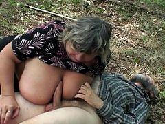 Perverted granny is sucking in the forest