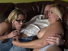 Enjoy watching two salacious blonde babes pleasing big cock sticking out pants. This exciting clothed sex video is everything you need right now.