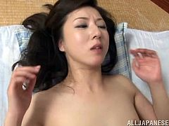 A sex addicted Japanese woman kisses a guy and gives him a skillful blowjob after having a dinner. This slim MILF takes off her clothes and gets fucked on a floor.