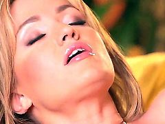 Turned on long haired blonde goddess Angela Sommers in white lace undies and high heels polishes shaved cunny in provocative positions on couch while hubby films everything in close up.