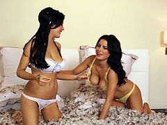 What are you waiting for? Watch these brunette twins, with giant jugs wearing sexy lingerie, while they play together with feathers.