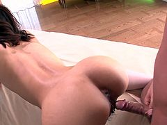 Seductive Asian girl with appetizing natural tits and sexy booty sucks two cocks in turn. She stands on her all four taking hard cock from behind while keeping on sucking another hard cock.