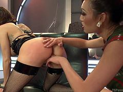 This little slut gets bent over by her tranny mistress Venus and she gets pounded hard by the big tranny dick from behind. She takes the cock in her pussy and licks the tip of Venus's shoe at the same time.