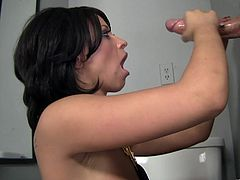 Get a load of Halie James' big natural tits in in this gloryhole scene where she sucks on a big cock while fingering her wet pussy.