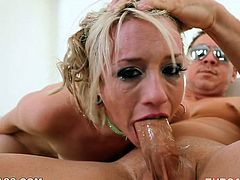 Judging by the way she is sucking on her lover's juicy pecker you can tell that she knows what oral sex is all about. This blondie will get your dick hard in a blink.
