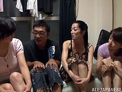 Watch these Asian hottie sharing this guy's hard cock in a group sex where they take turns sucking and fucking him as he's delighted.