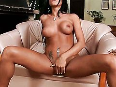 Ashley Bulgari with huge hooters and clean twat takes sex toy up her beaver after sexy striptease