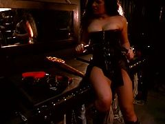 Spooky and dark place is being scene of domination and bondage where cute girl in latex outfit destroys his dick!
