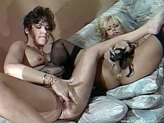Retro lesbians are fucking each other with a strapon