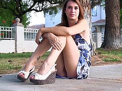 Have fun watching this brunette doll, with a nice ass wearing purple panties, while she masturbates sitting on the street in a solo model video.