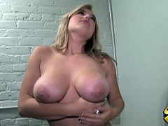 Dayna lets her huge tits bounce as she sucks this black guy then gets fucked hard from behind through the wall before taking a facial.