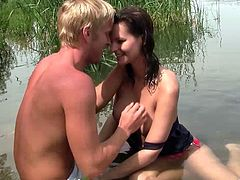 Check out this hardcore outdoors scene where this sexy brunette is fucked by this guy after sucking his cock by the edge of a lake.