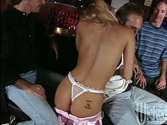 Sexy Jenna Jameson strips down and dances naked in a bar then lets one of the regular patrons bend her over and fuck her.