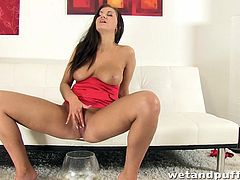This kinky slut fills a condom up with a bunch of golf balls then inserts it into her wet cunt. She queefs them out one by one into a glass that is laying on the floor. This dirty whore will put anything in her pussy hole, and she even pisses in the glass!