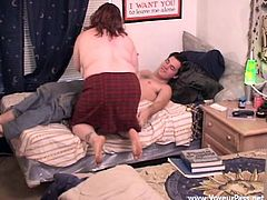 Get wild watching this brunette lady, with big knockers wearing a skirt, while she goes really hardcore with an aroused dude over a bed.