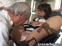 This asian maid is ready to do anything for her master. She is all tied up and helpless and he knows how to make her feel miserable and spanks her fine ass.
