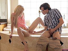 This geek pulls his cock out and plays with it and he rubs the sweet and inviting cunt of his girlfriend Skylar. The blonde babe wants to help him out so she let him finger her, but then her mom walks in and sees the entire thing. She's going to show her daughter how to properly sucks the guy's dick.