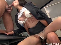 Slutty Asian chick goes wild in an office. She shows off her boobs and strokes her colleagues' dicks. Then the girl gets spit roasted. In the end she gets a mouthful of cum.