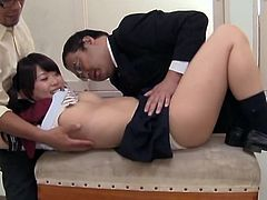 Pigtailed Japanese chick Emily Takahash is getting naughty with two men after exam. She shows her shaved snatch to the men and allows them to finger it.