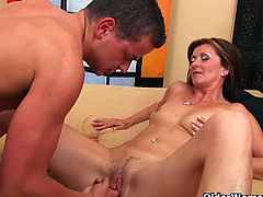 Sexy big titted and lusty cunt milf Dorothy strips off her clothes and plays with her pussy, but soon she is joined by a young dude who fucks her nicely and creams her face.