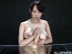 Well-endowed Japanese porn star Nanako Mori is playing with a dildo indfoors. She massages the toy with her jaw-dropping massive natural boobs and then pleases some dude with a titjob.