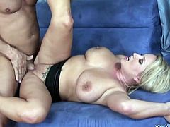 A lustful cougar sucks a dick and also licks balls with pleasure. Then Rachel also gives a skillful titjob and then gets banged on a sofa. This MILF enjoys this amazing sex because this guy is a good lover.