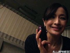 Skinny Japanese woman is getting naughty with her husband indoors. She massages the guy's shaft ardently and then takes it in her mouth.