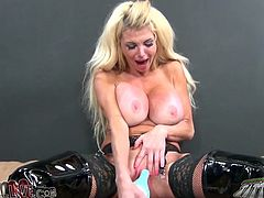 Busty blond MILF in latex jackboots Taylor Wane fucks herself with big sex toy