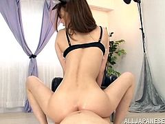 Slim Honami Uehara gives a footjob to a guy in a mask. This babe also sits on guy's face, so he can feel the taste of her pussy. Then Honami takes off her panties and rubs the ass against a dick.