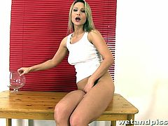 Long-haired blonde milf Samantha Jolie is having fun indoors. She pleases herself with fingering and then fills a big glass with her urine.