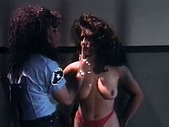 Sexy brunette wearing police uniform punishes blonde slut. She makes her take off clothes and start to finger fuck her pussy and stroke her juicy tits.