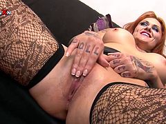 Sandy haired busty bitch with tattooed body sits on sofa with her legs spread apart and gets her moist kitty fisted passionately. Have a look at that dirty lesbian copulation in Porn XN sex clip!