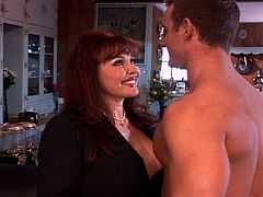 Redhead sexy milf is horny for wild sex and gets fucked hard by a muscled young dude. She teaches him a lesson about being late and decides to forgive him with his big dick in her ass!