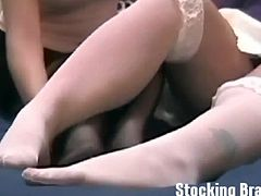 Sasha and Toni dirty in stockings. She licks and sucks Sasha's cream-colored nylons before taking them off and licking between her toes.   Sasha doesn't waste anytime removing Toni's stockings.