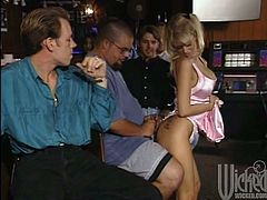 Make sure you take a look at this hardcore scene where the horny blonde is eaten out and fucked by a guy in a bar before she ends up with a mouthful of cum as everyone watches.